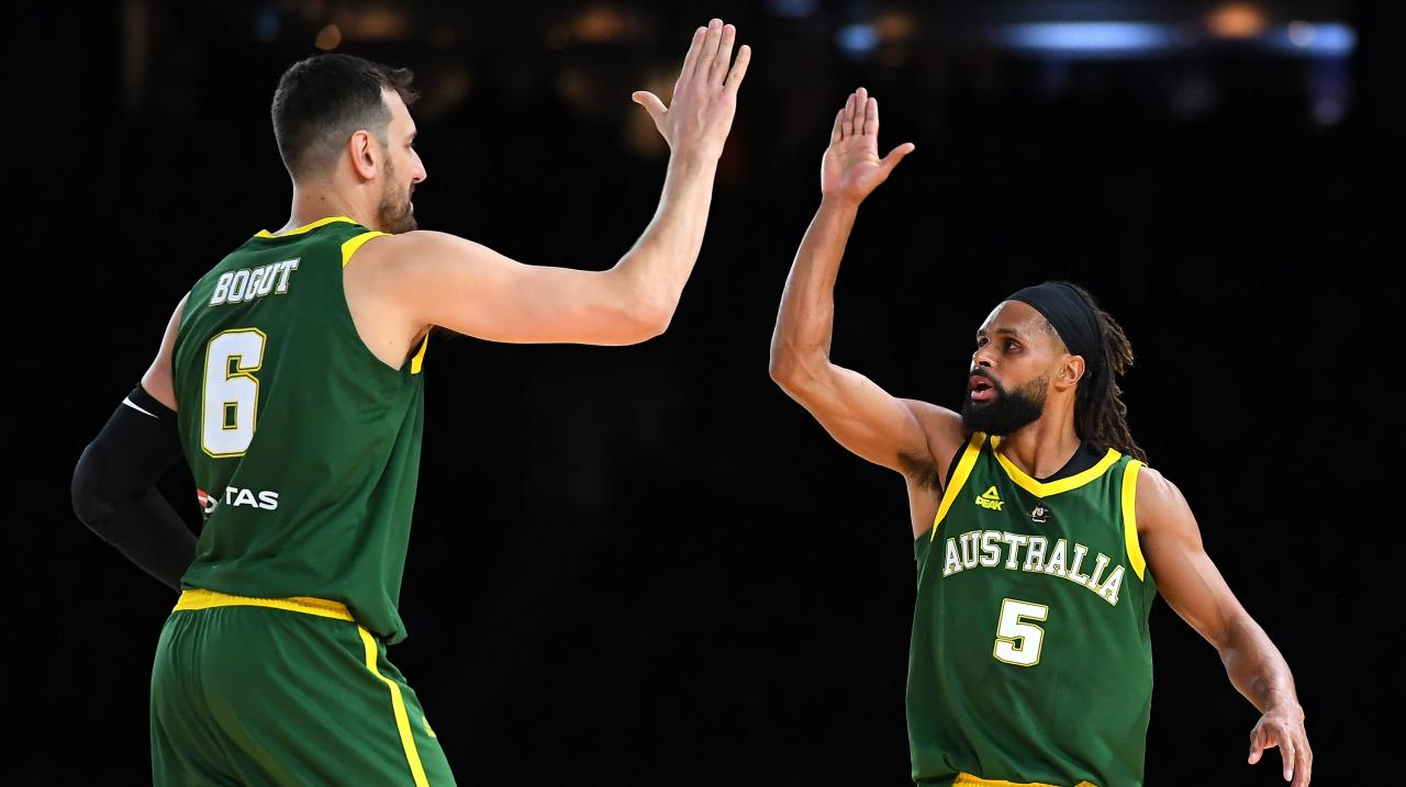 Andrew Bogut and Patrick Mills of the Boomers high five during the International Basketball Friendly match between the Australian Boomers and Team USA - Getty Images