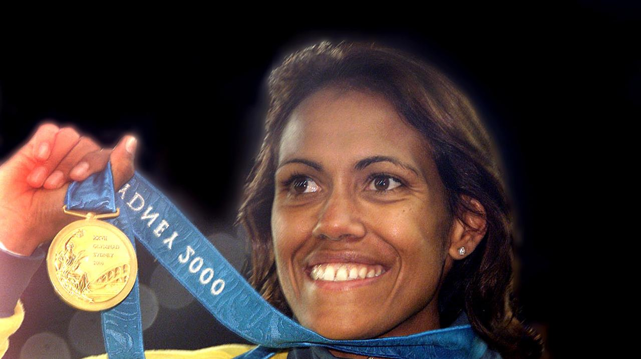 SYDNEY, AUSTRALIA - SEPTEMBER 25: (FILE PHOTO) Cathy Freeman of Australia celebrates with her Gold medal after winning the Women's 400m final at the Sydney 2000 Olympic Games, Sydney Australia (Getty Images)