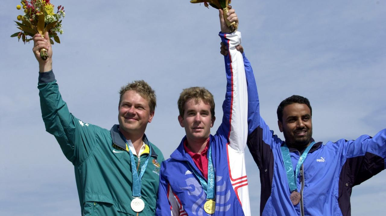 Gold Medalist Richard Faulds of Great Britain (centre), silver medalist Russell Mark of Austraila (left) and bronze medalist Fehaid Al Deehani of Kuwait after the mens double trap qualification during the Sydney 2000 Olympic Games at the Sydney Internatio