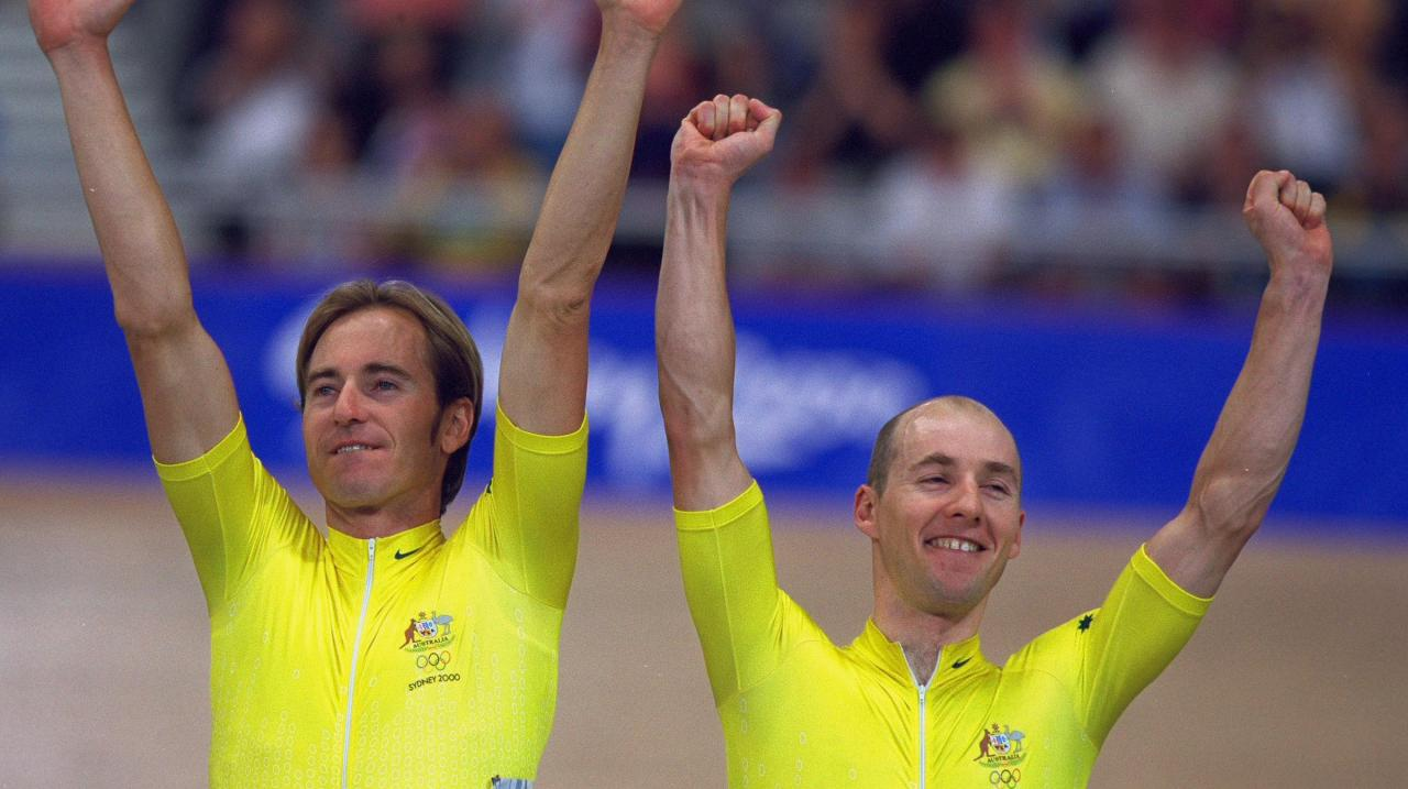 Scott McGrory and Brett Aitken of Australia on the podium after winning the Men's Track Cycling Madison Final at the Dunc Gray Velodrome in Bankstown on Day Six of the Sydney 2000 Olympic Games in Sydney, Australia. \ Mandatory Credit: MikePowell /Allspor
