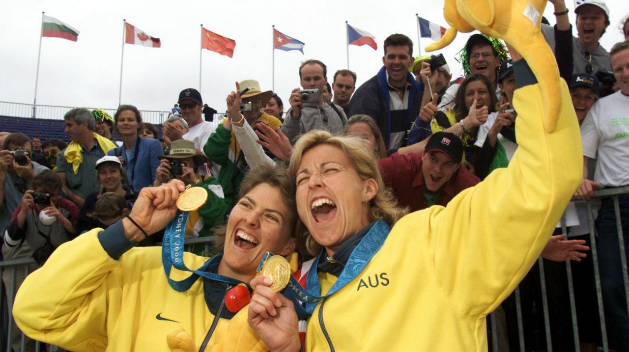 Natalie Cook and Kerri Pottharst of Australia celebrate after their win over Brazil to win the Gold medal, in the final of the Women's Beach Volleyball at the Sydney 2000 Olympic Games, held at the Beach Volleyball Centre in Bondi, Sydney,Australia. DIGIT