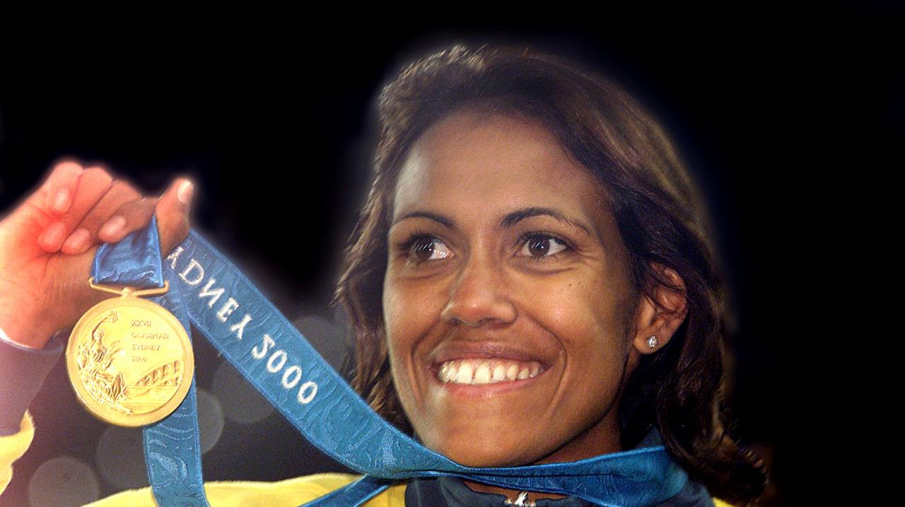 Cathy Freeman of Australia celebrates with her Gold medal after winning the Women's 400m final at the Sydney 2000 Olympic Games, Sydney Australia. DIGITAL IMAGE. Mandatory Credit: Hamish Blair/ALLSPORT