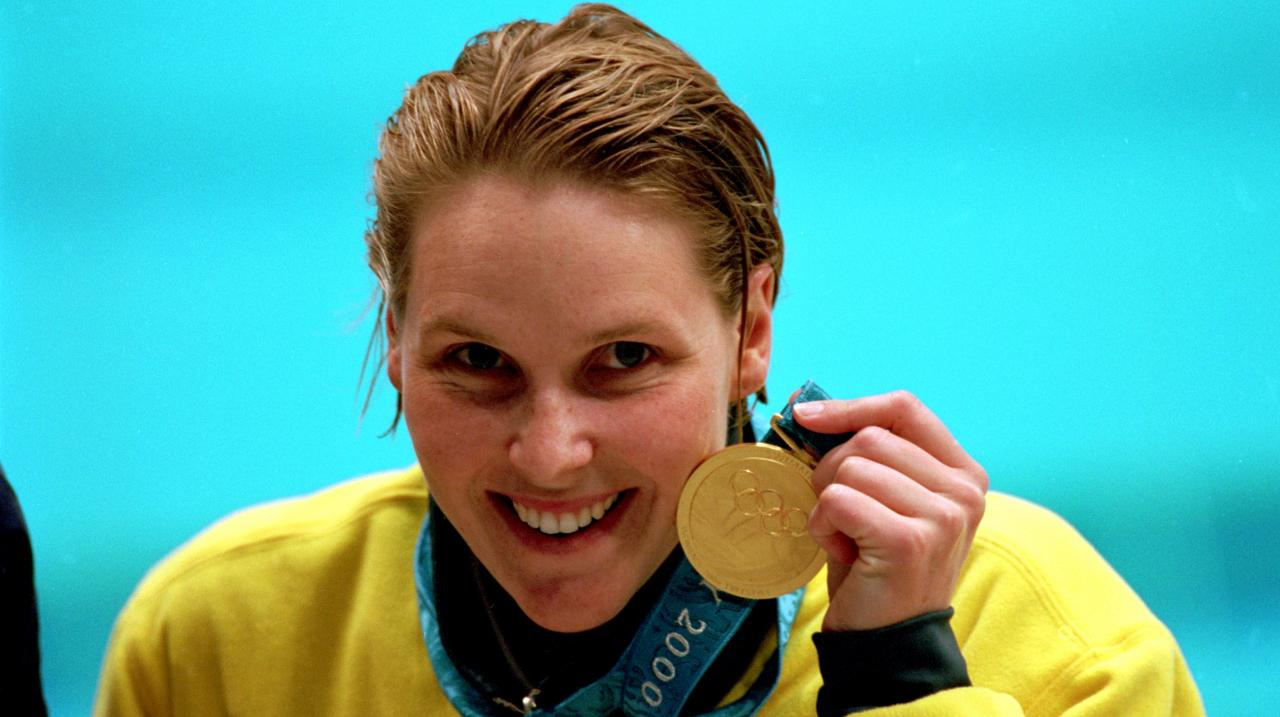 Susie O''Neill of Australia celebrates her gold medal victory in the Women's 200m Freestyle Final held at the Sydney International Aquatic Centre during the Sydney 2000 Olympics, Sydney, Australia. Mandatory Credit: Allsport UK/ALLSPORT