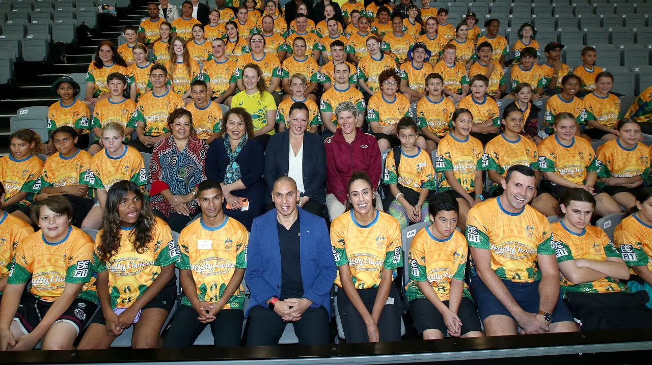 Students pose for a photo with former and current Olympic athletes including (front center left, Alex Winwood, front center, Patrick Johnson, and front left, Taliqua Clancy, during the launch of the Australian Olympic Committee 'Reflect' Reconciliation Ac