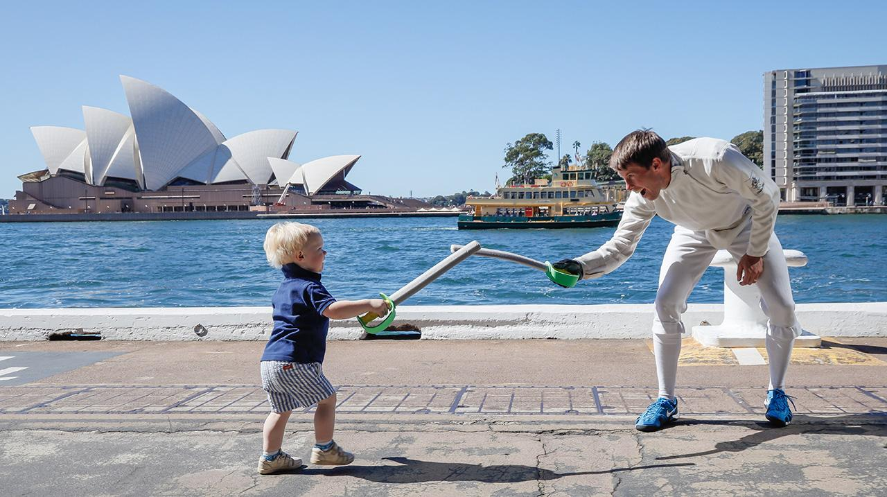 Edward Fernon plays with his son Lachlan during the Australian Olympic Committee 'Olympics Live' announcement at Tallawoladah Lawn on April 14, 2021 in Sydney, Australia