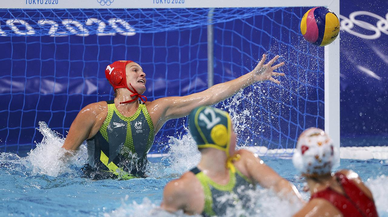 Bea Ortiz of Team Spain scores against Lea Yanistas of Team Australia during the Women's Preliminary Round Group A match between Spain and Australia on day seven of the Tokyo 2020 Olympic Games at Tatsumi Water Polo