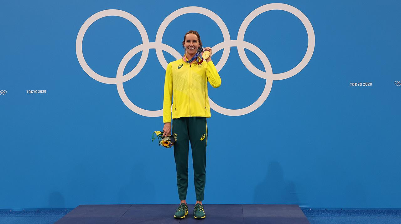 Gold medalist Emma McKeon of Team Australia shows her medal in the podium for Women's 50m Freestyle on day nine of the Tokyo 2020 Olympic Games at Tokyo Aquatics Centre