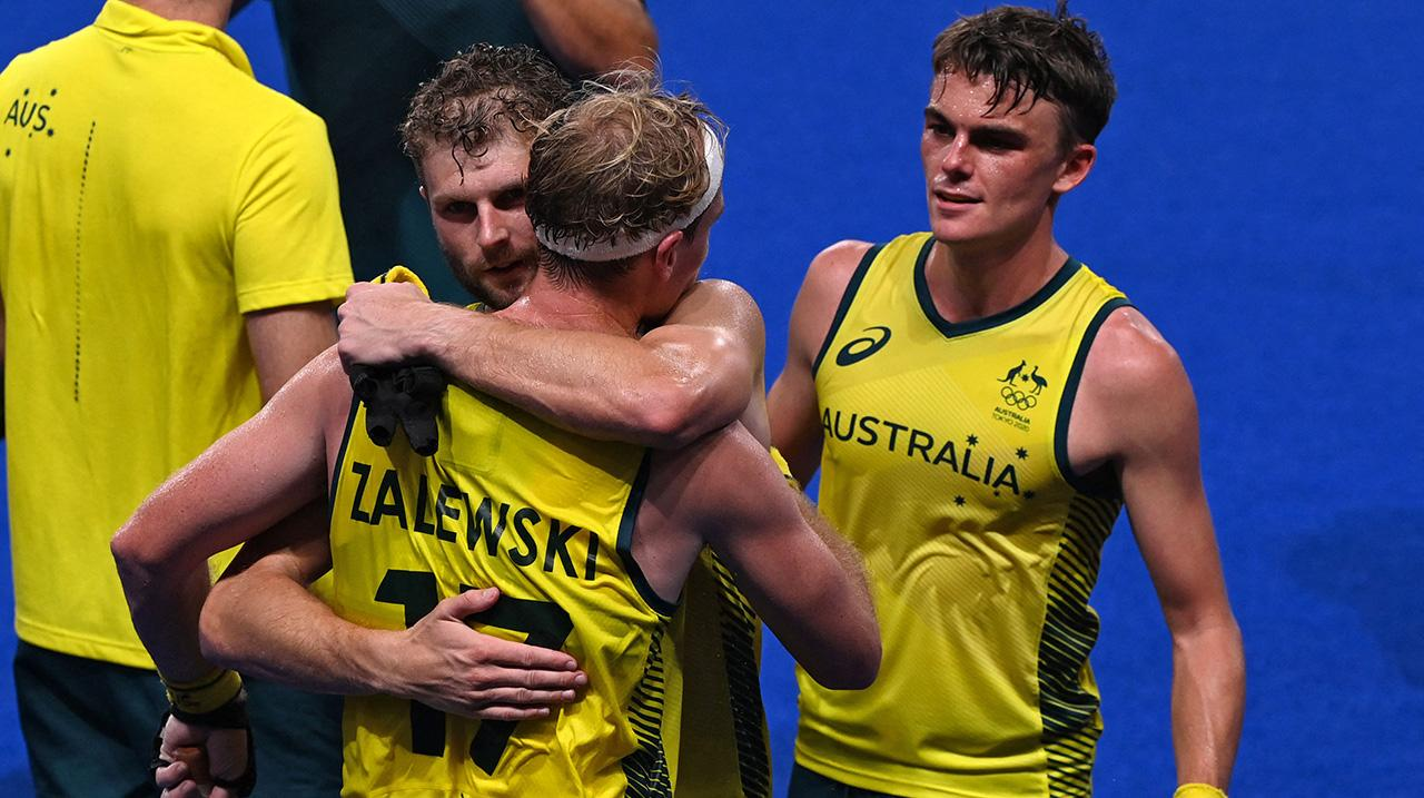 Australia celebrate after defeating Germany 3-1 in their men's semi-final match of the Tokyo 2020 Olympic Games field hockey competition, at the Oi Hockey Stadium in Tokyo