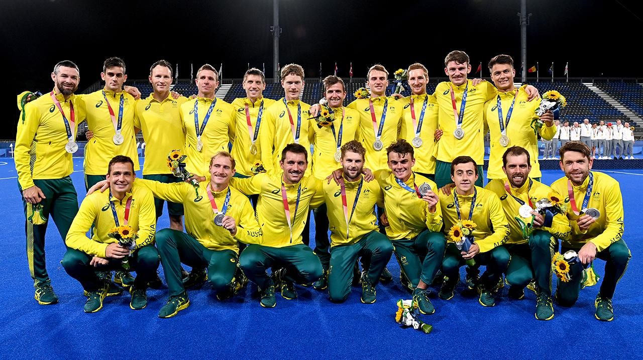 The Australian team poses for a photo after the gold medal final match between Australia and Belgium on day thirteen of the Tokyo 2020 Olympic Games at Oi Hockey Stadium on August 05, 2021 in Tokyo, Japan