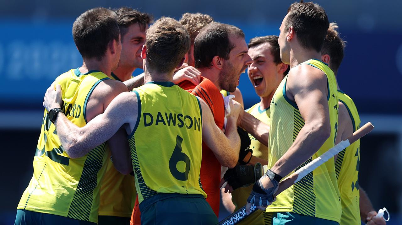 Andrew Lewis Charter and Matthew Dawson of Team Australia and teammates celebrate after winning the penalty shootout after the Men's Quarterfinal match between Australia and Netherlands on day nine of the Tokyo 2020 Olympic Games at Oi Hockey Stadium on A
